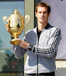 July 8, 2013 - London, UK - Andy Murray of Great Britain poses with the Gentlemen's Singles Trophy next to the Fred Perry statue at Wimbledon. (Credit Image: © I-Images/i-Images via ZUMA Press)