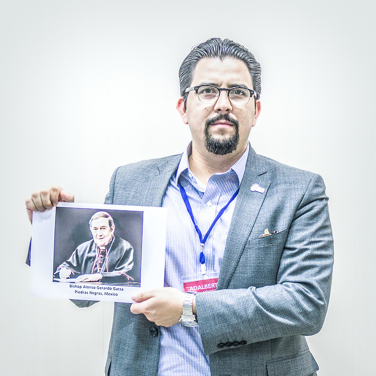2018<br /> Adalberto Mendez, an activist from Mexico, poses for a portrait showing a picture of the Bishop Alonso Gerardo Garza Treviño who is accused of obstruction of justice and complicity in the sexual abuses committed by the seminary's former rector, Juan Manuel Riojas Martínez, known as Father Meño. © Simone Padovani