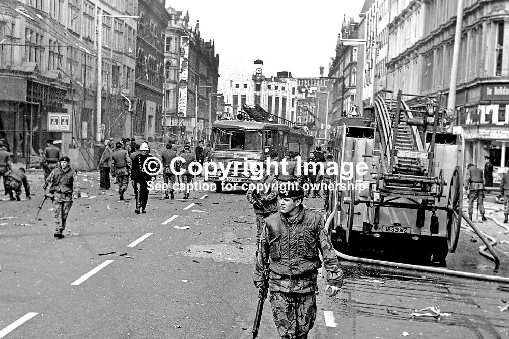 British soldiers seal off Royal Avenue, Belfast, N Ireland, following an explosion outside the former Grand Central Hotel in March 1974. The hotel  became even more of a target after it was taken over by the British Army as as a base and billet. 197403000216c.<br /> <br /> Copyright Image from Victor Patterson, Belfast, UK<br /> <br /> t: +44 28 9066 1296 (from Rep of Ireland 048 9066 1296)<br /> m: +44 7802 353836<br /> e: victorpattersonbelfast@gmail.com<br /> <br /> www.images4media.com<br /> <br /> Please see my full Terms and Conditions of Use at https://www.images4media.com/p/terms-conditions - it is IMPORTANT that you familiarise yourself with them.<br /> <br /> Images used online incur an additional cost. This cost should be agreed in writing in advance. Online images must be visibly watermarked i.e. © Victor Patterson or that of the named photographer within the body of the image. The original metadata must not be deleted from images used online.<br /> <br /> This image is only available for the use of the download recipient i.e. television station, newspaper, magazine, book publisher, etc, and must not be passed on to a third party. It is also downloaded on condition that each and every usage is notified within 7 days to victorpattersonbelfast@gmail.com.<br /> <br /> The right of Victor Patterson (or the named photographer) to be identified as the author is asserted in accordance with The Copyright Designs And Patents Act (1988). All moral rights are asserted.