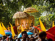 20 SEPTEMBER 2015 - SARIKA, NAKHON NAYOK, THAILAND: The Ganesha deity in the procession to a local river for its immersion at the Ganesh festival at Shri Utthayan Ganesha Temple in Sarika, Nakhon Nayok. Ganesh Chaturthi, also known as Vinayaka Chaturthi, is a Hindu festival dedicated to Lord Ganesh. Ganesh is the patron of arts and sciences, the deity of intellect and wisdom -- identified by his elephant head. The holiday is celebrated for 10 days. Wat Utthaya Ganesh in Nakhon Nayok province, is a Buddhist temple that venerates Ganesh, who is popular with Thai Buddhists. The temple draws both Buddhists and Hindus and celebrates the Ganesh holiday a week ahead of most other places.    PHOTO BY JACK KURTZ