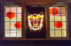 © Licensed to London News Pictures. 08/02/2019. Bristol, UK. Window Wanderland in BS9. A display for the start of the Chinese New Year, in the first part of a weekend of window art in Bristol. Window Wonderland was started in 2015 and aims to bring people together by helping them to put on community events, build relationships, strengthen neighbourhoods, create pride and spread friendship, positivity, happiness and goodwill. Photo credit: Simon Chapman/LNP