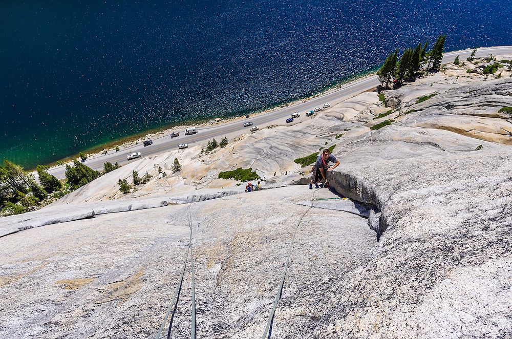 Rock climbers on Stately Pleasure Dome above Tenaya lake, Tuolumne Meadows, Yosemite National Park, California USA