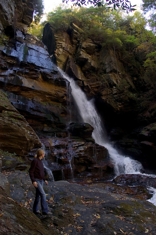 ASHEVILLE, NC - OCTOBER 30: A hiker looks at a waterfall in Pisgah National Forest, in the Appalachian Mountains outside Asheville in North Carolina.(Photo by Logan Mock-Bunting) Sarah VDP hikes through Pisgah National Forest near Asheville, North Carolina.