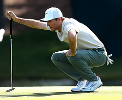 May 3, 2018 - Charlotte, NC, USA - Russell Henley lines up a putt on the 16th green during he first round of the Wells Fargo Championship at Quail Hollow Club in Charlotte, N.C., on Thursday, May 3, 2018. (Credit Image: © Jeff Siner/TNS via ZUMA Wire)