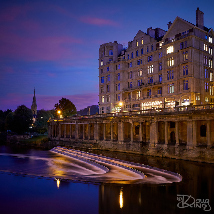 The River Avon and historic buildings in the centre of the city of Bath in late evening light.<br /> Bath, Avon, UK