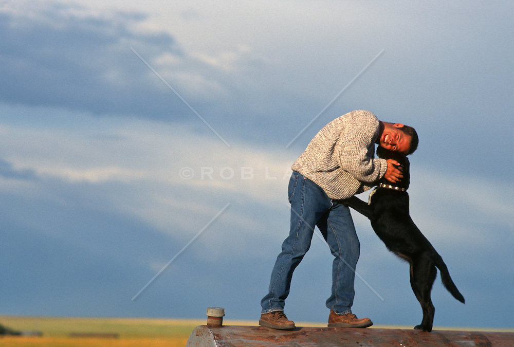 Man enjoying time with a black lab in New Mexico