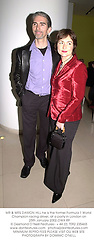 MR & MRS DAMON HILL he is the former Formula 1 World Champion racing driver, at a party in London on 25th January 2002.	OWX 89