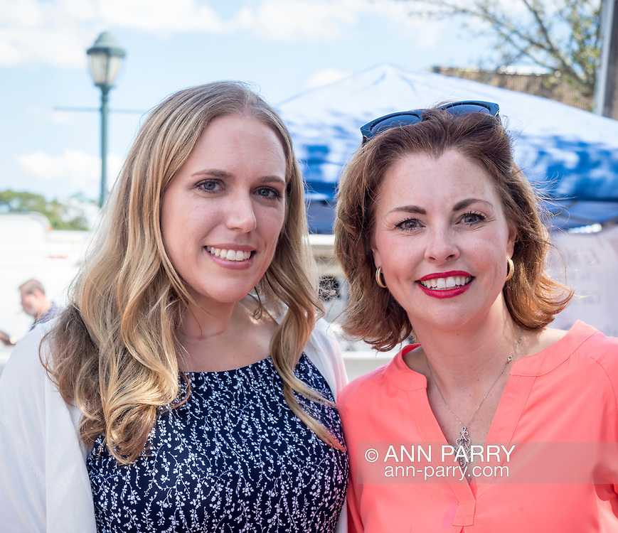 Merrick, NY, USA. Sept. 9, 2017. L-R, SUE MOLLER, (Democrat - Merrick), candidate for Town of Hempstead Council District 6; and ERIN KING SWEENEY, (Republican - Wantagh) Town of Hempstead Councilwoman District 5, pause chatting to pose for photo at Merrick Fall Festival.