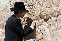 © Licensed to London News Pictures. 02/05/2014. Jews pray at the Western Wall in the Old City of Jerusalem.  The Western Wall is the most important shrine in Judaism. FILE PICTURE TAKEN 30/4/14. Photo credit : Richard Isaac/LNP