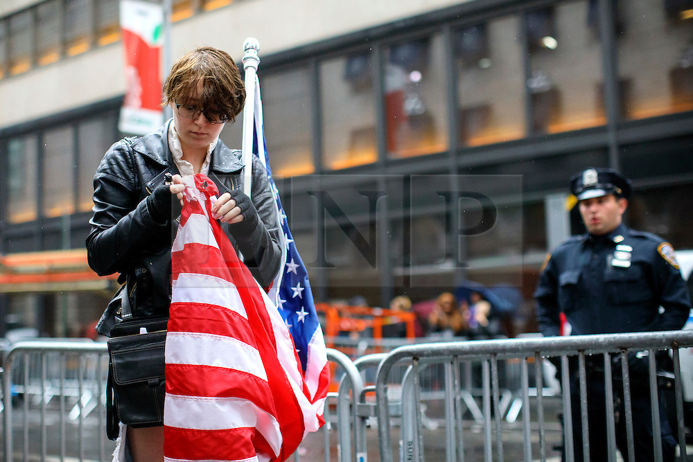 © Licensed to London News Pictures. 09/11/2016. New York CIty, USA. A pro-Clinton supporter protests outside Trump Tower in New York City, on Wednesday, 9 November 2016 following the presidential election won by Donald Trump. Photo credit: Tolga Akmen/LNP