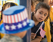 Students and staff participate in a parade celebrating American history and veterans at Barrick Elementary School, November 6, 2014.