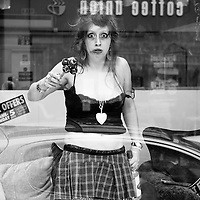 As part of Streets Ahead various shop windows on Bold Street had.living mannequin's in by a group called Cacahute. I think she was playing the role of Amy Winehouse.