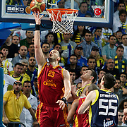 Galatasaray CC's Ermal KURTOGLU (L) during their Turkish Basketball Legague Play-Off final fifth match Fenerbahce between Galatasaray at the Sinan Erdem Arena in Istanbul Turkey on Tuesday 14 June 2011. Photo by TURKPIX