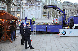 BERLIN, Dec. 22, 2016  A cement barrier is placed by police around the reopened Christmas market at the Breitscheid Square in Berlin, capital of Germany, on Dec. 22, 2016. The Christmas market here attacked on Monday, was reopened on Thursday.  gl) (Credit Image: © Shan Yuqi/Xinhua via ZUMA Wire)