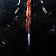Crews in action during The 49th Head of the Charles Regatta on the Charles River which separates Boston and Cambridge, Massachusetts, USA. The Head of Charles began in 1965, is the worlds largest two day rowing event with over 9000 competitors from around the globe competing. The course is 3 miles (4,800 meters) long and stretches from the start at Boston University's DeWolfe Boathouse near the Charles River Basin, passing Harvard University to the finish just after the Eliot Bridge. Boston, Massachusetts, USA. 19th October 2013. Photo Tim Clayton