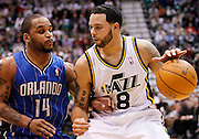 Utah Jazz point guard Deron Williams (8) attempts to get past Orlando Magic point guard Jameer Nelson (14) during the second half of an NBA basketball game in Salt Lake City, Friday Dec. 10, 2010. Williams scored 32 points in Utah's 117-105 win. (AP Photo/Colin E Braley)