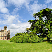 Downton Abbey's Highclere Castle Panorama. Highclere Castle, in Hampshire, is the home of the Earl and Countess of Carnarvon and is used in the filming of the British TV series Downton Abbey.