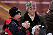 Moscow, Russia, 20/02/2005..Russians eating hamburgers outside a McDonalds restaurant by the entrance to Red Square.