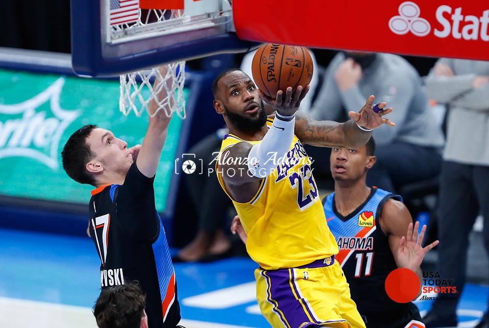 Jan 13, 2021; Oklahoma City, Oklahoma, USA; Los Angeles Lakers forward LeBron James (23) goes to the basket as Oklahoma City Thunder forward Aleksej Pokusevski (17) defends during the second half at Chesapeake Energy Arena. Mandatory Credit: Alonzo Adams-USA TODAY Sports