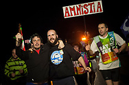 """People run on the 20th Korrika. Castejon (Basque Country). April 1, 2017. The """"Korrika"""" is a relay course, with a wooden baton that passes from hand to hand without interruption, organised every two years in a bid to promote the basque language. The Korrika runs over 11 days and 10 nights, crossing many Basque villages and cities. This year was the 20th edition and run more than 2500 Kilometres. Some people consider it an honour to carry the baton with the symbol of the Basques, """"buying"""" kilometres to support Basque language teaching. (Gari Garaialde / Bostok Photo)"""