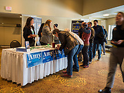 02 FEBRUARY 2020 - CEDAR RAPIDS, IOWA: People register to get into a campaign event for Senator Amy Klobuchar (D-MN) in Cedar Rapids. Sen. Klobuchar campaigned to support her candidacy for the US Presidency Sunday in Iowa. She is trying to capitalize on her recent uptick in national polls. Iowa holds the first selection event of the presidential election cycle. The Iowa Caucuses are Feb. 3, 2020.    PHOTO BY JACK KURTZ