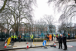 London, UK. 6th February, 2021. National Eviction Team bailiffs, HS2 workers and police officers take part in an operation to remove environmental activists from anti-HS2 campaign group HS2 Rebellion from tunnels beneath Euston Square Gardens. The activists entered tunnels dug by them beneath the site eleven days ago in order to seek to protect trees from felling in connection with the HS2 high-speed rail project.