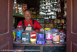 Kelly Modlin plays shop keeper on our first rest stop of the trip during Day-1 of our Himalayan Heroes adventure riding from Kathmandu to Daman, Nepal. Tuesday, November 6, 2018. Photography ©2018 Michael Lichter.