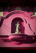 View of a statue of Virgin Mary on the wall of a pink house, Leon, Nicaragua