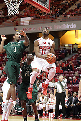 05 December 2015: MiKyle McIntosh(11) goes airborne from the baseline against Chris Cokley. Illinois State Redbirds host the University of Alabama - Birmingham Blazers at Redbird Arena in Normal Illinois (Photo by Alan Look)