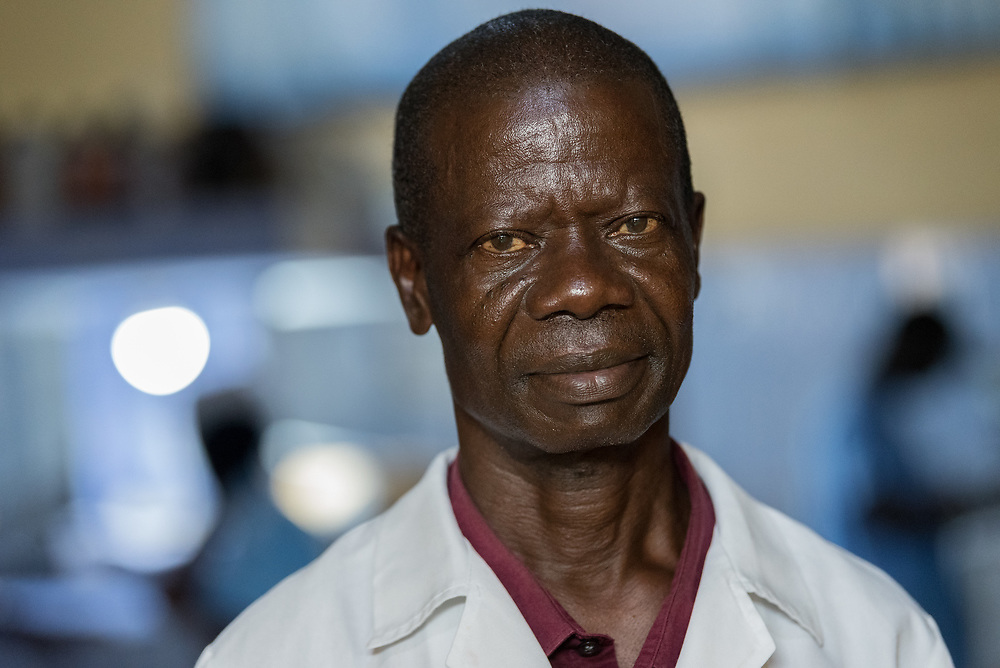 2 November 2019, Ganta, Liberia: Assistant supervisor Jefferson Zigbuo leads the work at Ganta Hospital lab. Located in Nimba county, the Ganta United Methodist Hospital serves tens of thousands of patients each year. It is a founding member of the Christian Health Association of Liberia.