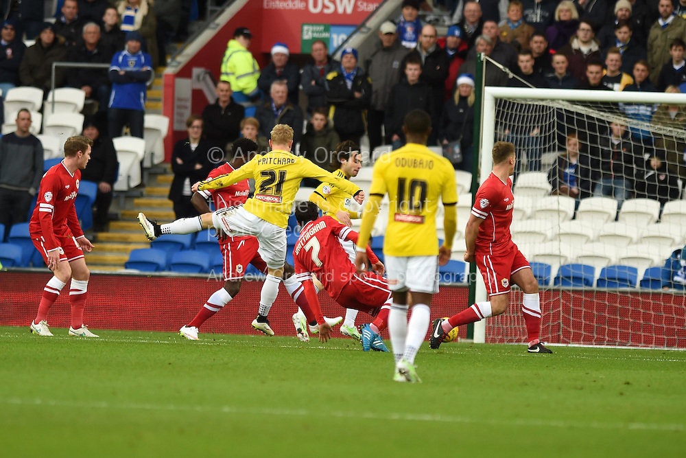 Alex Pritchard of Brentford  (21) shoots and scores his teams 1st goal. Skybet football league championship match, Cardiff city v Brentford at the Cardiff city stadium in Cardiff, South Wales on Saturday 20th December 2014<br /> pic by Andrew Orchard, Andrew Orchard sports photography.