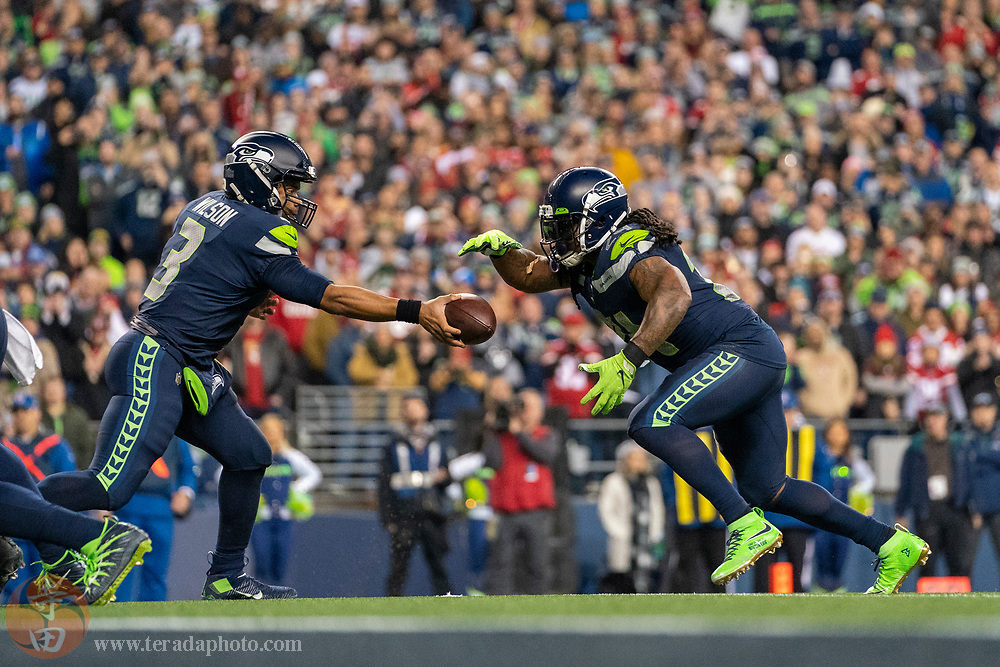 December 29, 2019; Seattle, Washington, USA; Seattle Seahawks running back Marshawn Lynch (24) receives the hand off from quarterback Russell Wilson (3) during the fourth quarter against the San Francisco 49ers at CenturyLink Field.