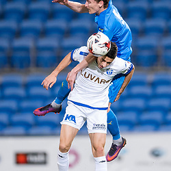 BRISBANE, AUSTRALIA - SEPTEMBER 20: Matthew Schmidt of Gold Coast City heads the ball over Stefan Zinni of South Melbourne during the Westfield FFA Cup Quarter Final match between Gold Coast City and South Melbourne on September 20, 2017 in Brisbane, Australia. (Photo by Gold Coast City FC / Patrick Kearney)