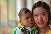 """Despite suffering from cerebral palsy, Tam has been able to make significant progress. He receives daily physical therapy from his mother and CBM filed workers. His mother says, """"No matter what happened to Tam, we would never give up""""."""