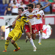 Ethan Finlay, (left), Columbus Crew, is challenged by Tim Cahill, New York Red Bulls, during the New York Red Bulls Vs Columbus Crew, Major League Soccer regular season match at Red Bull Arena, Harrison, New Jersey. USA. 12th July 2014. Photo Tim Clayton
