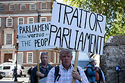 Brexit protesters with Traitor Parliament message in Westminster on the day after Parliament voted to take control of Parliamentary proceedings and prior to a vote on a bill to prevent the UK leaving the EU without a deal at the end of October, on 4th September 2019 in London, England, United Kingdom. Yesterday Prime Minister Boris Johnson faced a showdown after he threatened rebel Conservative MPs who vote against him with deselection, and vowed to aim for a snap general election if MPs succeed in a bid to take control of parliamentary proceedings to allow them to discuss legislation to block a no-deal Brexit.