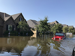 August 31, 2017 - Houston, Texas, U.S. - Flooded houses in Riverstone neighborhood, southwest of the Greater Houston. The two dams of Addicks and Barker in the West of Houston began to discharge on Monday due to the rising water levels caused by the tropical storm Harvey. The discharging resulted in new flooding areas along the Brazos River. Local officials are warning that more than 500 square km of the areas will likely be inundated with water from the river, which is projected to continue rising through Friday. (Credit Image: © Gao Lu/Xinhua via ZUMA Wire)