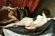 Rokeby Venus, also called The Toilet of Venus, Venus and Cupid, Venus at her Mirror, c1647-1651. Oil on canvas.  Diego Velasquez (1599-1660) Spanish painter. Damaged by British suffragette Mary Richardson in 1914. Mythology Nude Deity