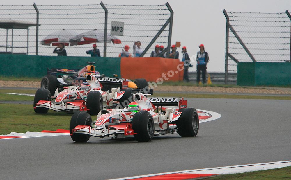 Super Aguri-Honda drivers Sakon Yamamoto and Takuma Sato fight hard in the opening stages of the 2006 Chinese Grand Prix in Shanghai. Photo: Grand Prix Photo