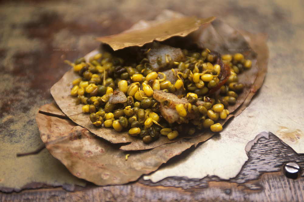 Moong Dal sprouts. Lentil sprouts mixed with onion and vegetable served on a leaf as a plate.