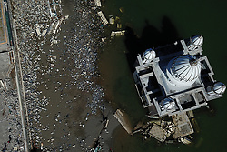 Oct. 8, 2018  - Palu, Sulawesi, Indonesia - Aerial view of the debris after the earthquake and tsunami in Palu, Central Sulawesi. The death toll from multiple powerful quakes and an ensuing tsunami striking Central Sulawesi province on September 28 jumped to 1,948 on Monday and rescuers fear more than 5,000 others could still be missing, according to a disaster agency. (Credit Image: © Wang Shen/Xinhua via ZUMA Wire)