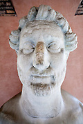 ancient Greek style sculpture head, at the Vatican museum Rome Italy