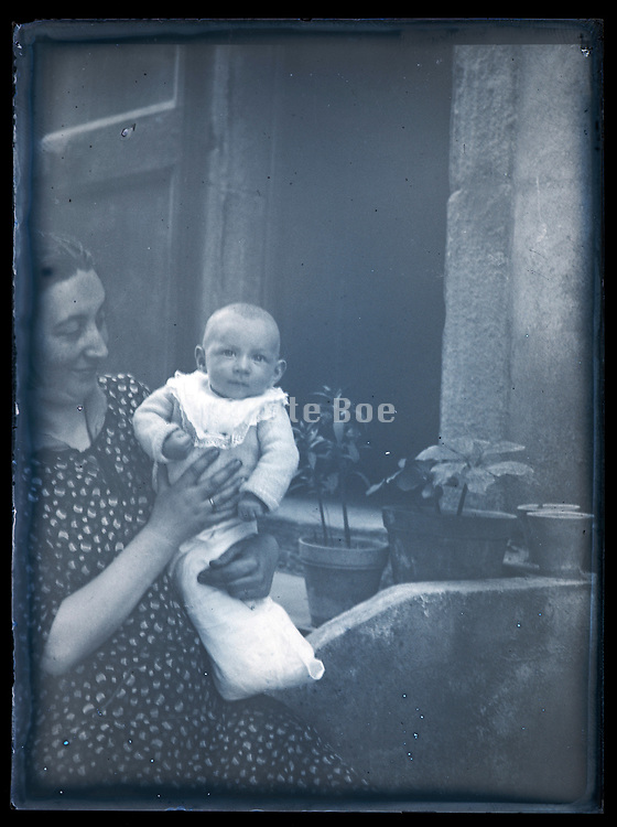 happy mother holding baby toddler France ca 1920s