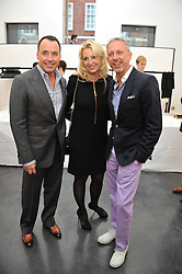 Left to right, DAVID FURNISH, BEATRICE WARRENDER and PATRICK COX at a private view of photographs by Herb Ritts held at Hamiltons Gallery, 13 Carlos Place, London on 21st June 2011.