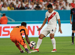 March 23, 2018 - Miami Gardens, Florida, USA - Peru midfielder Anderson Santamaria (4) delivers the ball to Peru goalkeeper Carlos Cáceda (12) during a FIFA World Cup 2018 preparation match between the Peru National Soccer Team and the Croatia National Soccer Team at the Hard Rock Stadium in Miami Gardens, Florida. (Credit Image: © Mario Houben via ZUMA Wire)