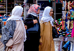 Three women in traditional dress going shopping in the medina in Marrakech, Morocco, North Africa<br /> <br /> (c) Andrew Wilson | Edinburgh Elite media