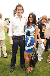 The HON.WILL ASTOR and his wife LOHARLEE at a luncheon hosted by Cartier for their sponsorship of the Style et Luxe part of the Goodwood Festival of Speed at Goodwood House, West Sussex on 4th July 2010.