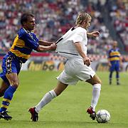 Manchester United's David Beckham has his shirt pulled by Parma's Sebastiano Siviglia