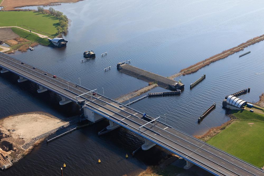 Nederland, Flevoland-Overijssel, Ramspol, 01-05-2013; nieuwe Ramspolbrug in de N50 met naast de brug de balgstuw. De vaargeul het Ramsdiep met de strekdam.<br /> Ramspol, inflatable dike, between Ketelmeer and Black Water. The Balgstuw (bellow barrier) is a storm barrier and consists of an inflatable dam or dyke, composed of three bellows. Usually, each bellow rests on the bottom of the water, but now the bellows are inflated  because of maintenance.<br /> luchtfoto (toeslag op standard tarieven)<br /> aerial photo (additional fee required)<br /> copyright foto/photo Siebe Swart