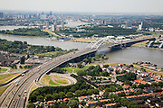 Nederland, Zuid-Holland, Rotterdam-Zuid, 04-07-2006;  zicht op de meanderende rivier de Nieuwe Maas met de Van Brienenoordbrug; rechtsonder dorpskern Oud IJsselmonde; verstedelijking, urbanisatie, skyline .luchtfoto (toeslag); aerial photo (additional fee required); .foto Siebe Swart / photo Siebe Swart